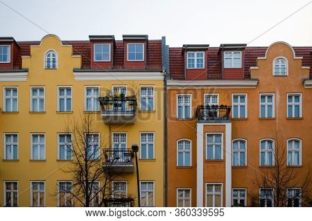Front View Of Two Facades Of Yellow And Orange Colors Of Typical Houses In The German District Of Fr
