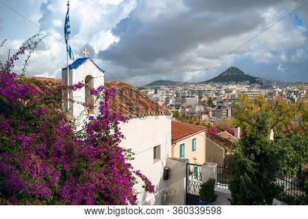 View Of Lycabettus Hill And City Under The Clouds From Anafiotika Neighborhood In The Old Town Of At