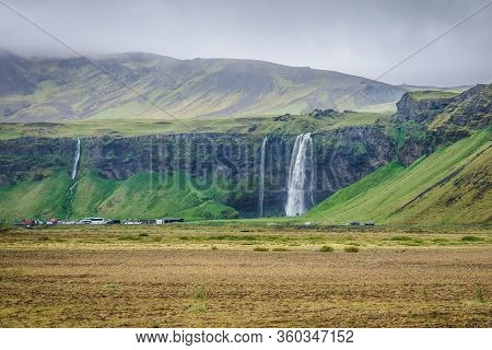 Distance View Of Two Waterfalls - Fosstunsfoss And Seljalandsfoss In Southern Iceland