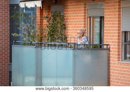 A woman dancing in balcony after Spain imposed a lockdown to slow down the spread of the coronavirus disease in Valencia, Spain on April 5, 2020.