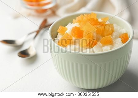 Delicious Rice Pudding With Dried Apricots On White Table, Closeup