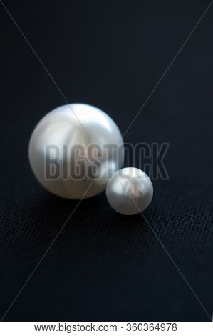 Pearls Close-up. Macro Pearls. Pearls On A Black Background.