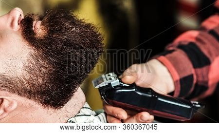 Brutal Bearded Guy Getting Beard Haircut By Hairdresser At Barbershop, Close Up. Getting Perfect Sha