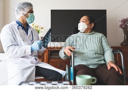 Latin American Doctor Checking Patient Infected Of Covid-19 At Home. Doctor Checking Patient With Co