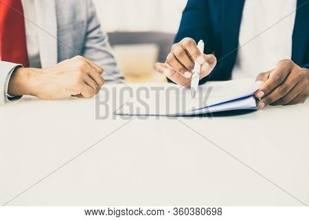 Cropped Shot Of Business People Reading Contract. Close-up Partial View Of Professional Business Col