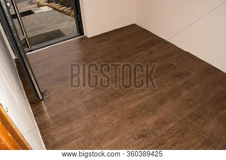 Laminate Flooring. Threaded Panel Of A Laminate Floor On A Thermally Insulated Floor. Electric Under