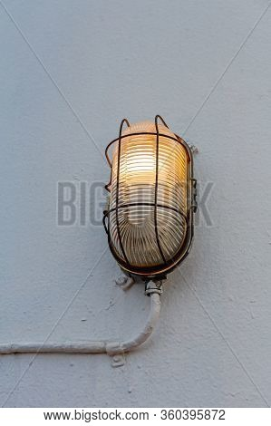 Old Incandescent Lamp Fixture At Ship Outdoor Wall