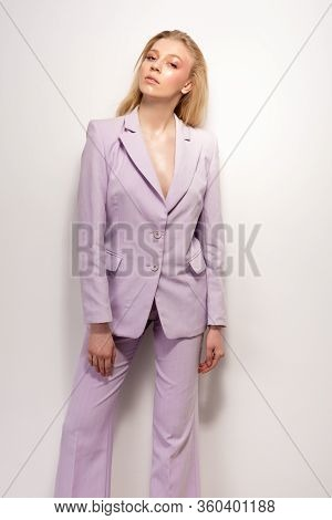 Young Girl In A Lilac Business Suit