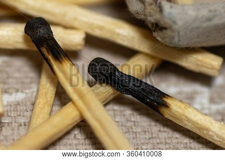 Close-up Top View Of A Pile Of Burnt Matches. Background. A Lot Of Burnt Matches