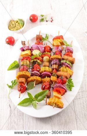 vegetarian barbecue party with corn, tomato, onion, tofu