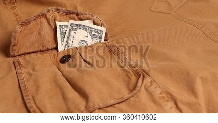 Financial Crisis. There Are A Few Dollars Sticking Out Of My Coat Pocket. Pocket Money For Small Exp
