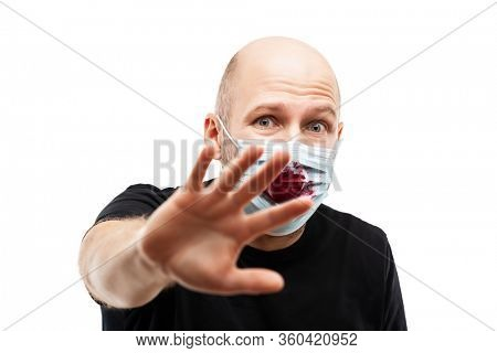 Human population virus, infection, flu disease prevention and industrial exhaust emissions protection concept - bald head man wearing bloody cough respiratory protective medical mask hand hiding face