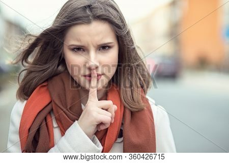 Shh Woman Wide Eyed Asking For Silence Or Secrecy With Finger On Lips Hush Hand Gesture Cityscape Ou