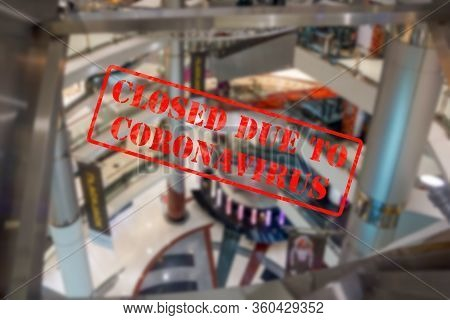 Defocused, Blurred View Of Interior Of An Upmarket Shopping Centre Or Mall, Empty And Closed Due To
