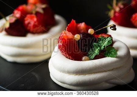 Meringue Dessert Pavlova Cake With Fresh Berries On Plate. Summer Dessert. French Cake. Confectioner