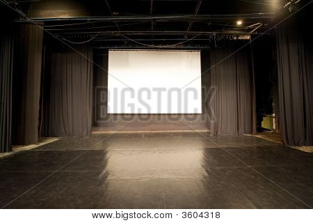 Empty Cinema Stage With A Big White Screen