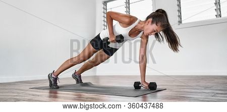 Home fitness plank row workout Asian woman training arms doing rowing exercise planking with dumbbell weights inside. one arm row exercising indoors. Panoramic banner.