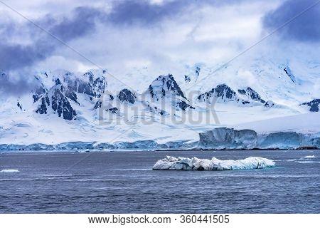 Iceberg Snow Mountains Blue Glaciers Dorian Bay Antarctic Peninsula Antarctica.  Glacier Ice Blue Be