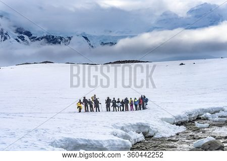 Damoy Point, Antarctica - December 26, 2020 Snowshoers Hiking Snow Mountains Damoy Point Antarctic P