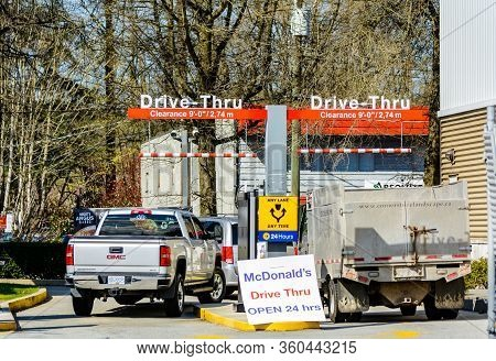 N. Vancouver - Apr 7, 2020: Cars Line Up Before Lunchtime At Mcdonalds For Fast Food During Covid-19