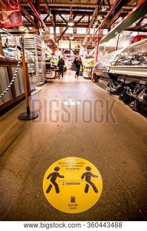 Vancouver, Canada - Apr 7, 2020: Social Distancing Sign On Floor Of Granville Island Market During C