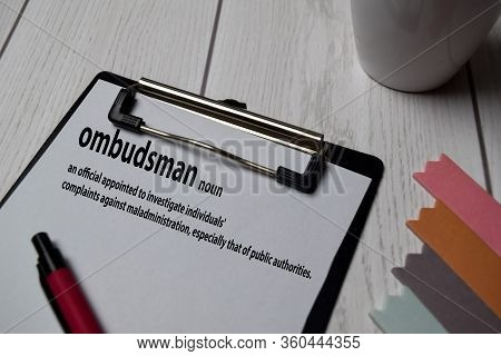 Definition Of Ombudsman Word With A Meaning On A Book. Dictionary Concept