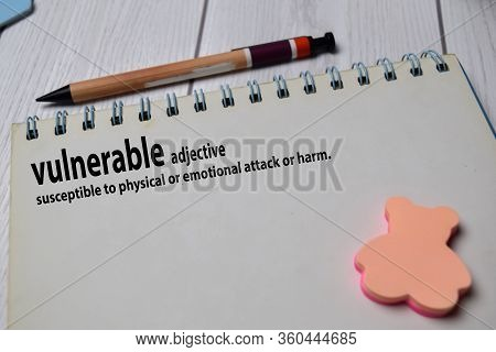 Definition Of Vulnerable Word With A Meaning On A Book. Dictionary Concept