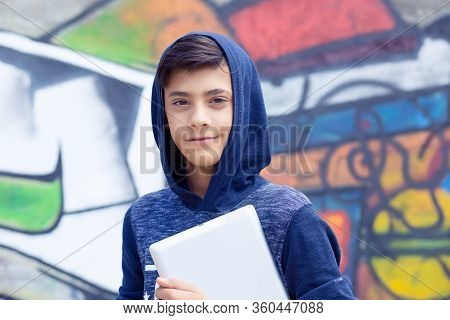 Happy Smiling Young Man, Boy Looking At You Camera Holding Tablet Pad Present Touch Screen With Copy