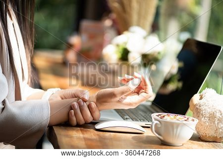 Closeup Woman Holding Her Wrist Pain From Using Computer. Office Syndrome Hand Pain By Occupational