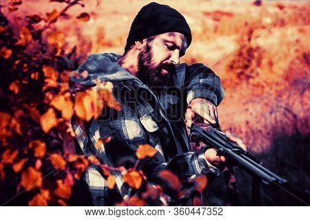 Hunter With Shotgun Gun On Hunt. Autumn Hunting Season. Closed And Open Hunting Season. Poacher In T