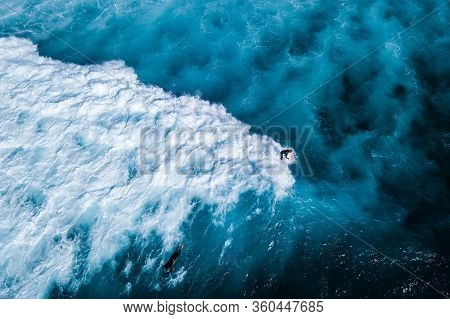 Surfer Ride On The Waves In The Ocean, Top View Of Surfer At The Top Of The Wave