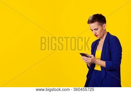 Portrait Young Angry Woman Unhappy, Annoyed By Something, Someone On Her Cell Phone Texting, Receivi