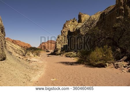 Ancient Rock Formations Eroded By Water And Wind. Reddish Stone Formations. Desert Landscape