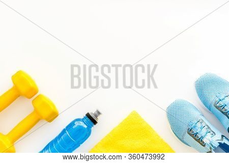Athletics Accessories. Dumbbells, Towel, Sneakers On White Background Top-down Copy Space