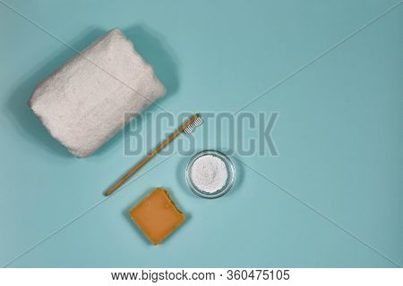 Toothbrush, Toothpowder, Towel And Soap On A Blue Background. Eco-friendly Bamboo Toothbrush.