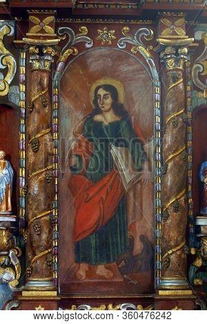 LAZ, CROATIA - JULY 14, 2014: St. John the Evangelist altarpiece at St. Andrew's Church in Laz, Croatia