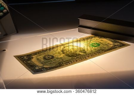 Verifying The Authenticity Of The Two-dollar Bill In Penetrating Light. Us Banknotes. Thomas Jeffers