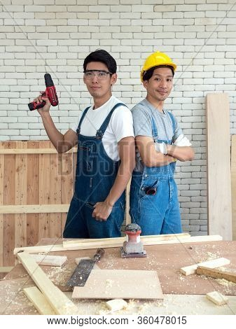Two Asian Carpentry Poses Confidently Before Beginning The Job Of Receiving Orders At The Wood Worki