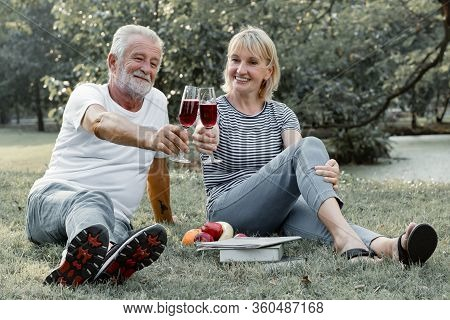 Couple Seniors Sipping Wine Fruity Together With Happy Face.