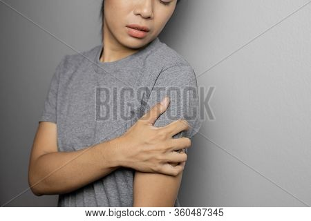 Woman Suffering From Pain In Arm.