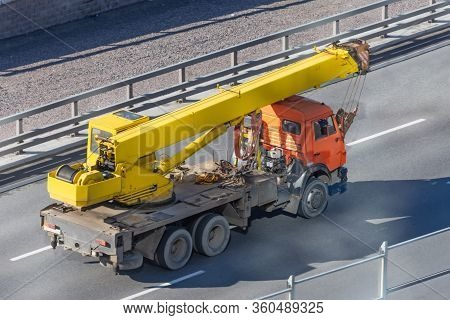 Mobile Yellow Big Crane Truck Rides On The Highway