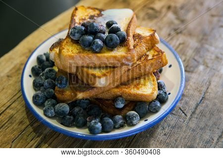 Toasted Bread With Bluberries - French Toast With Berries Blueberries, Strawberries And Sauce, Tradi
