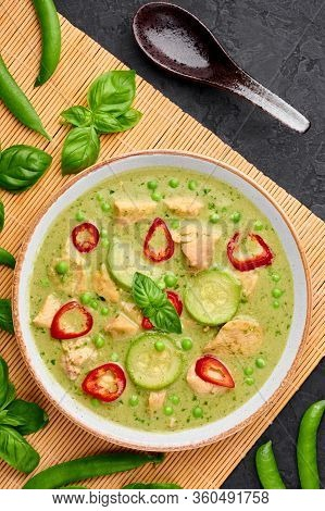 Thai Green Curry With Chicken Or Gaeng Kaew Wan Gai In White Bowl At Black Slate Background. Thai Gr