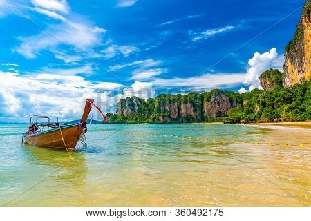 Single Long Tail Boat On The Water At Famous Railay Beach In Krabi Town, Thailand. Typical Image Of