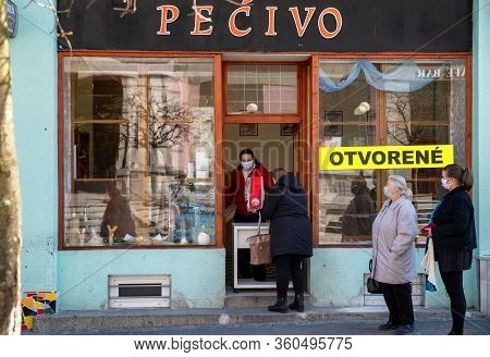 Ruzomberok, Slovakia - April 7: People With Face Masks Standing In Front Of Shop. Social Distance Du