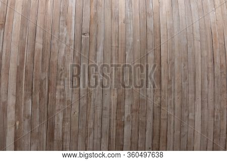 A Close Up View Of Long Slats Of Wood Making Up The Underneath Of A Roof