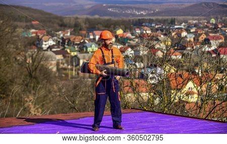 Building House. Apply Plastic Coatings Membranes Fiberglass Or Felt Over Sloped Roofs Before Applyin