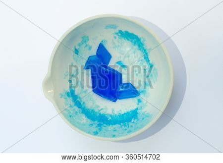 A White Porcelain Evaporating Basin Containing Large Blue Hydrated Copper Sulphate Crystals Isolated