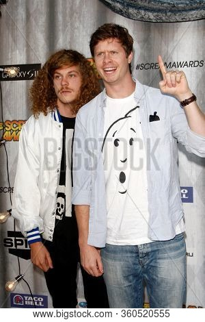 LOS ANGELES - OCT 15:  Anders Holm, Blake Anderson at the Scream Awards 2011 at the Universal Studios on October 15, 2011 in Los Angeles, CA