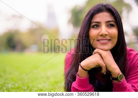 Happy Young Beautiful Persian Woman Relaxing At The Park